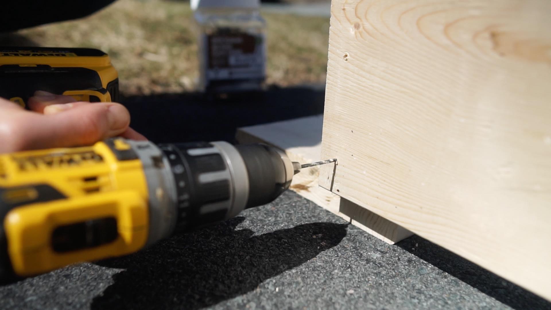 dewalt drill drilling a hole in wood