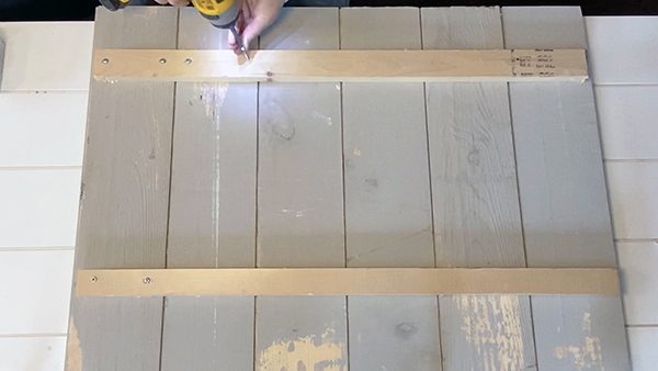 Assemble the sign by putting wood screws through the strapping