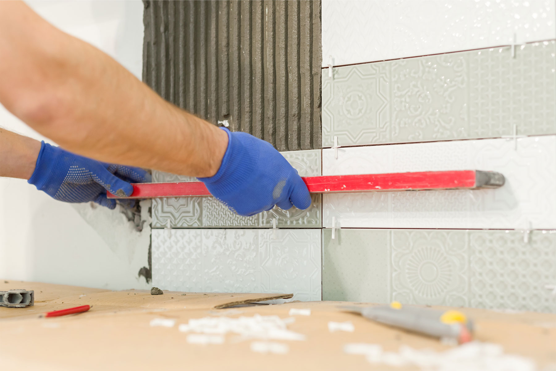 Set tile spacers and use a grout float to ensure everything is even.