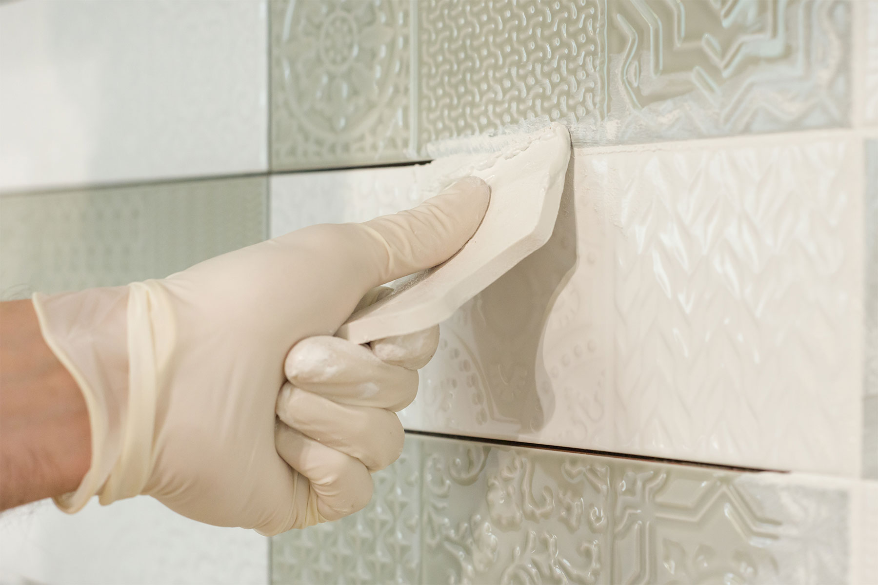 Allow your tile to set for 24 hours before grouting.