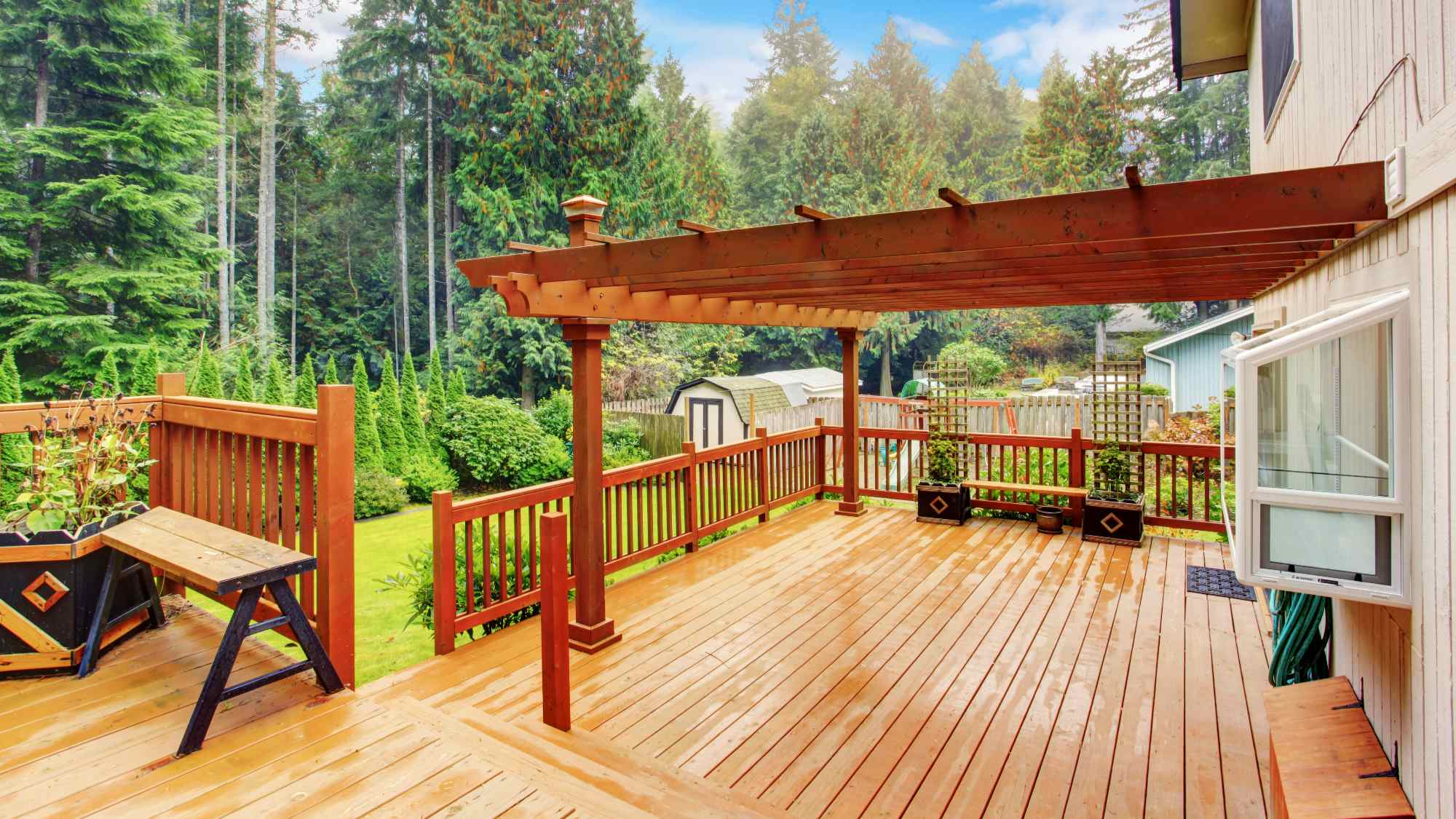 brown stained deck with a pergola