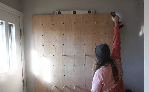 screwing pegboard into wall
