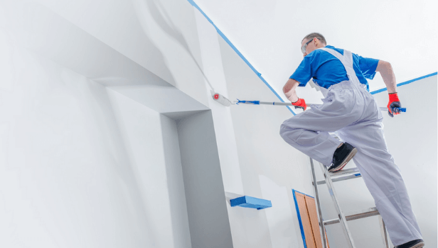painting a wall with an extendable roller