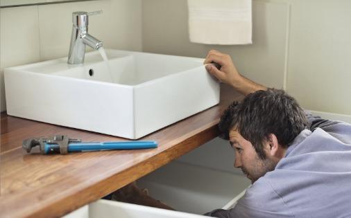 person installing bathroom vanity