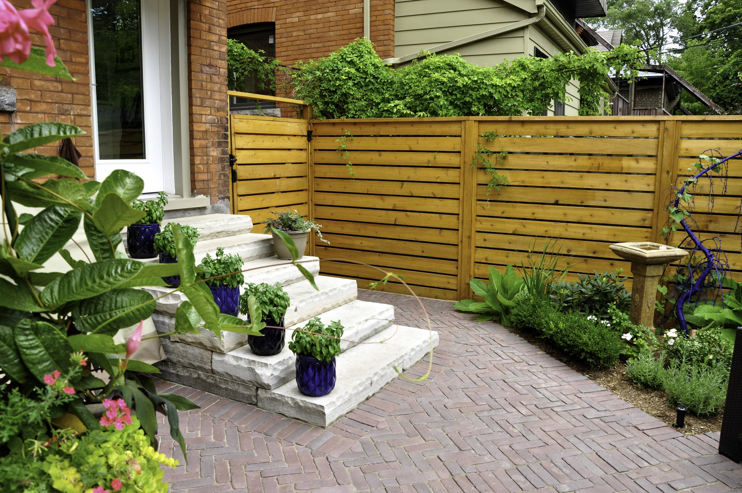 fenced patio with planters