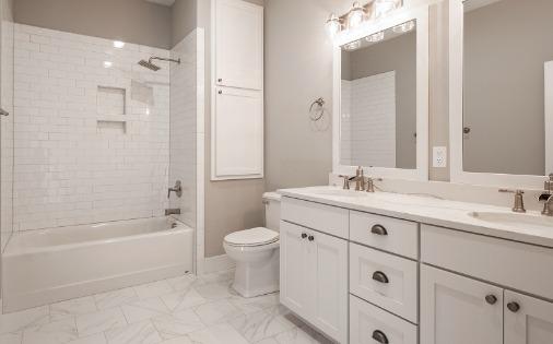 white double vanity and bathtub
